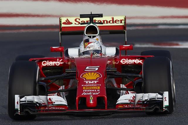 Sebastian Vettel a connu une excellente journée au... (AP, Siu Wu)