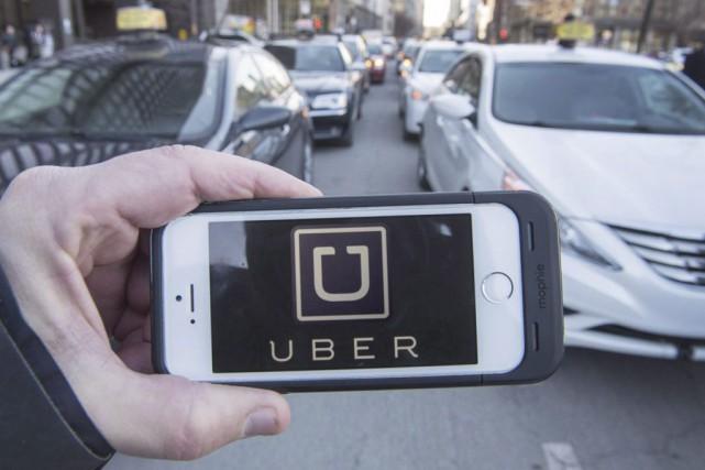 L'entreprise Uber mène des opérations dans 40 villes... (PHOTO RYAN REMIORZ, ARCHIVES LA PRESSE CANADIENNE)
