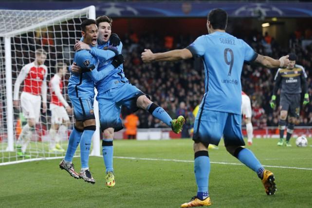 Deux buts de Lionel Messi ont mené le FC Barcelone à une victoire convaincante... (PHOTO AP)