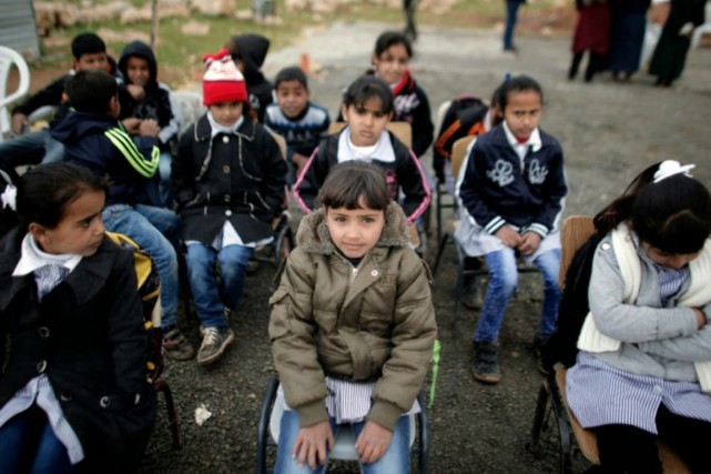 Les 25 élèves, âgés de 7 ou 8... (PHOTO AHMAD GHARABLI, AFP/LIBÉRATION)