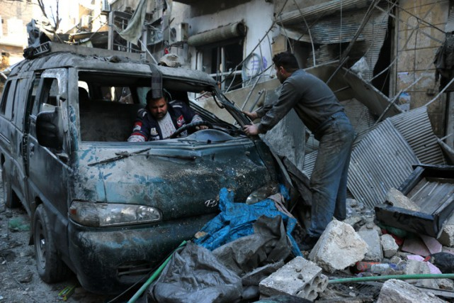 Le régime Assad, tout en disant oui à... (PHOTO AFP)