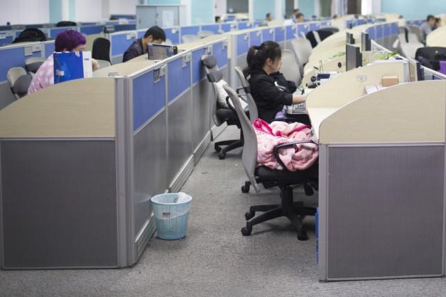 Une fonctionnaire fédérale a obtenu le droit de travailler à distance... de son... (Photo archives Bloomberg)