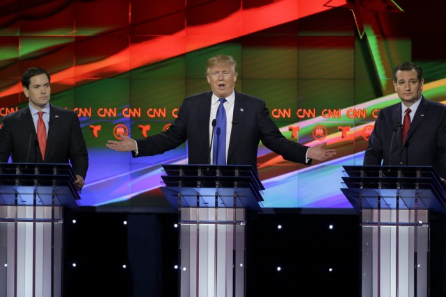 Donald Trump, entouré de Marco Rubio et Ted... (Photo David J. Phillip, AP)
