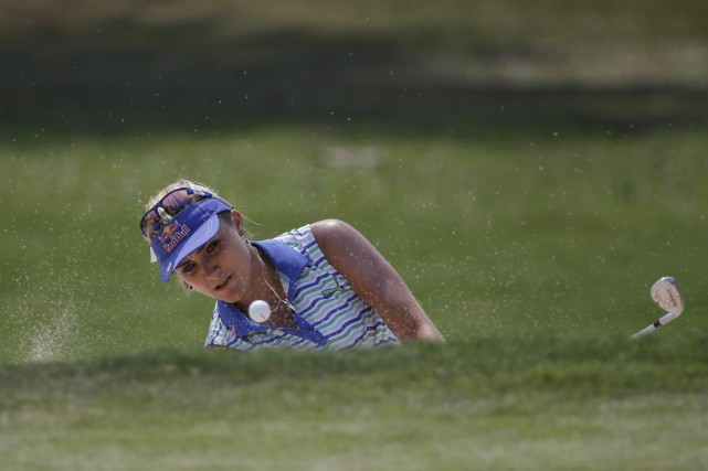 Lexi Thompson... (PHOTO SAKCHAI LALIT, AP)