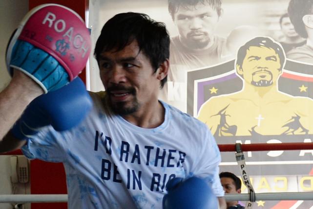 Manny Pacquiaoest actuellement en pourparlers avec son promoteur... (Photo Ted Aljibe, archives AFP)