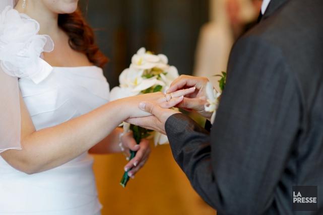Pour Philippe Couillard, le mariage religieux vient avec... (123RF/maximkabb)