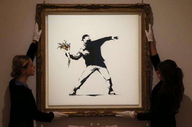 Une oeuvre de Bansky.... (PHOTO ARCHIVES AP)