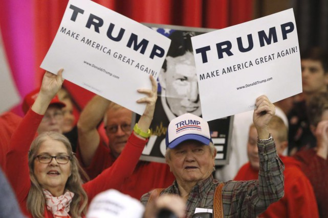 Des partisans de Donald Trump à Wichita, au... (Photo Charles Rex Arbogast, AP)