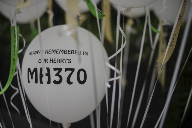 Un événement commémoratif a eu lieu à Kuala... (PHOTO MOHD RASFAN, AGENCE FRANCE-PRESSE)