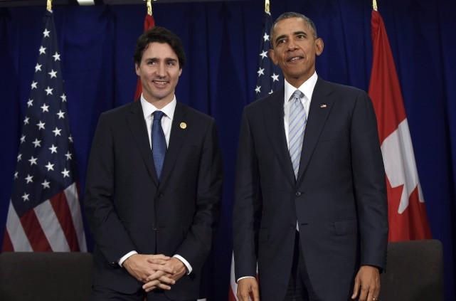 Justin Trudeau et Barack Obama lors d'une rencontre... (AP, Susan Walsh)