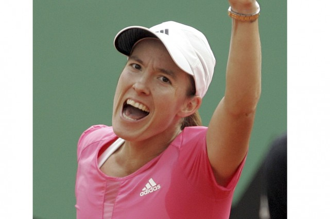 Justine Henin a remporté sept titres du Grand... (Archives Associated Press)