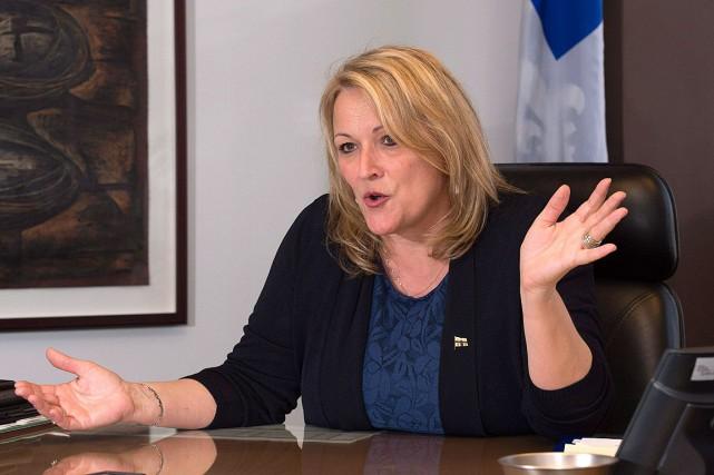 La ministre responsable de la Condition féminine,Lise Thériault... (Jacques Boissinot, Archives PC)