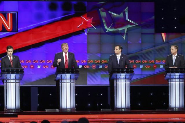 Le débat jeudi soir oppose les candidats encore... (Photo Wilfredo Lee, AP)