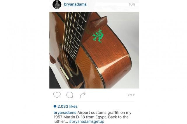 Adams a posté la photo de sa guitare... (Agence France-Presse)