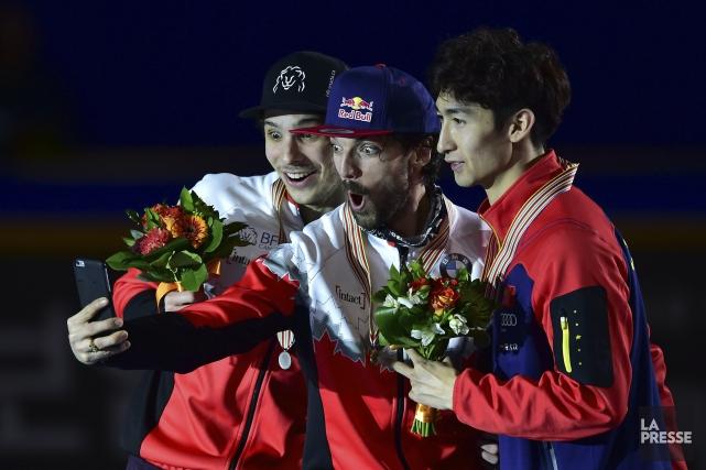 Médaillé d'or au 1000 m, Charles Hamelin (au... (AFP, Jung Yeon-Je)
