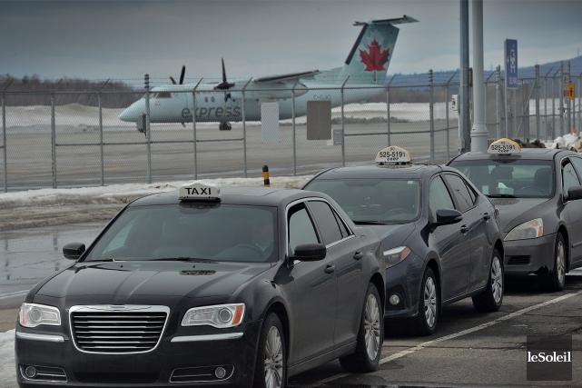 À Québec, les chauffeurs de taxi mèneront une... (Le Soleil, Patrice Laroche)