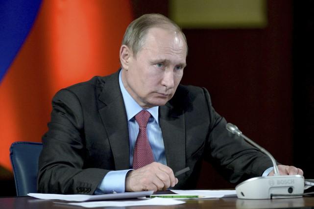 Le président russe Vladimir Poutine aannoncé le retrait... (AP, Alexei Nikolsky)