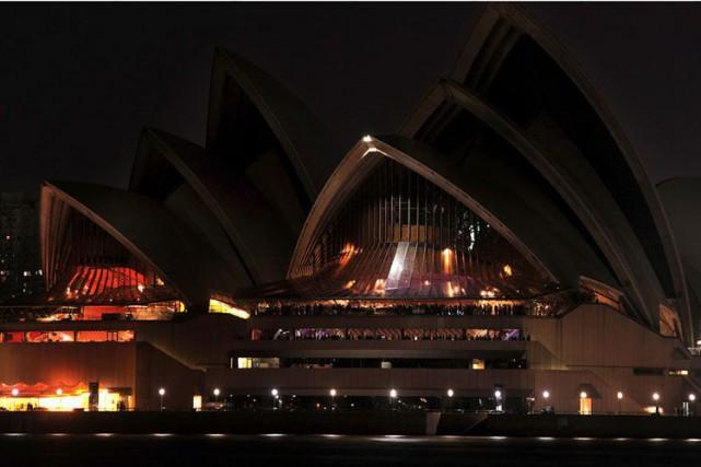 Les lumières de l'Opéra de Sydney éteintes à... (Photo archives AFP)
