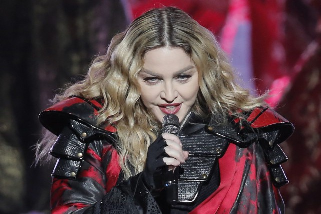Madonna, lors d'un spectacle de sa tournée Rebel... (PHOTO KIN CHEUNG, ARCHIVES ASSOCIATED PRESS)