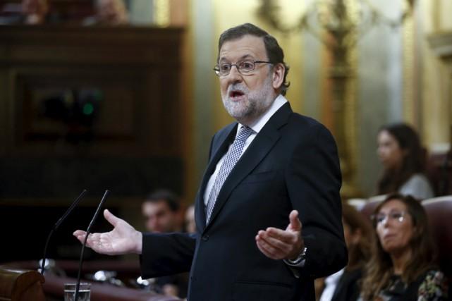 Mariano Rajoy, président du Parti populairedepuis onze ans,... (PHOTO REUTERS)