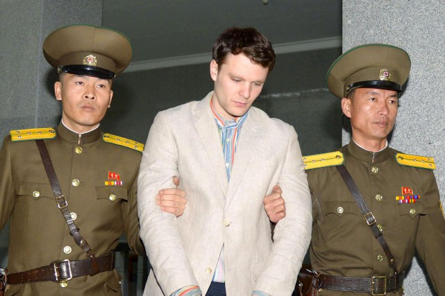 Otto Warmbier (au centre)... (PHOTO REUTERS)