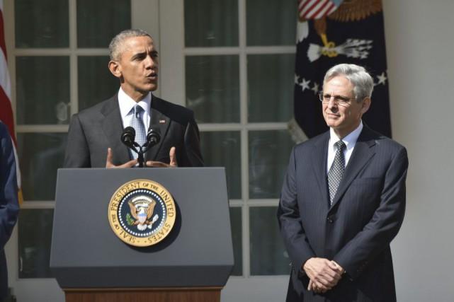 Barack Obama et Merrick Garlandlors de la conférence... (PHOTO NICHOLAS KAMM, AFP)