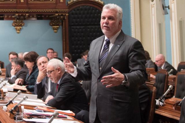 Le premier ministre Philippe Couillard assure avoir agi... (La Presse Canadienne, Jacques Boissinot)