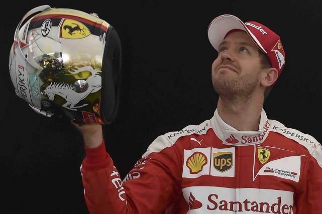 Sebastian Vettel croit que Ferrari a tous les... (AFP, Paul Crock)