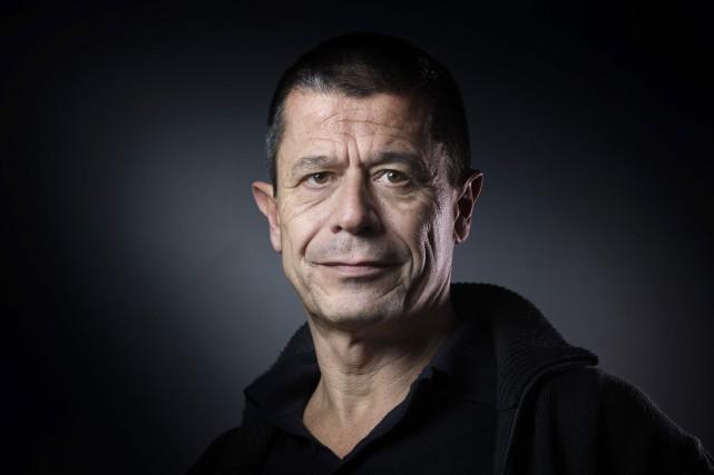 À la fois écrivain et journaliste, Emmanuel Carrère... (PHOTOJOËL SAGET, AGENCE FRANCE-PRESSE)