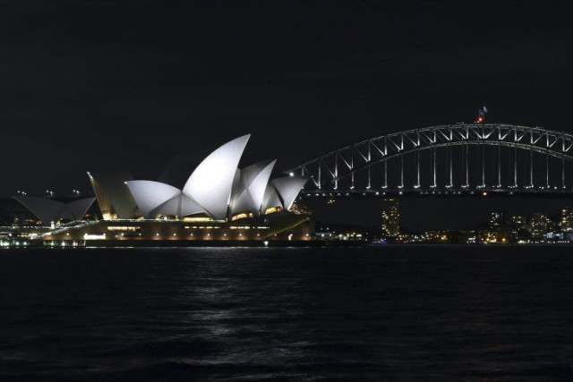 À Sydney, de nombreux immeubles du port ont... (PHOTO WILLIAM WEST, AFP)