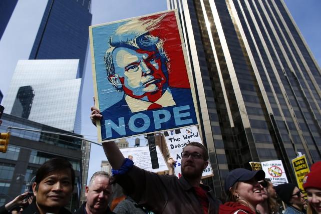 Le slogan de la campagne de 2008 de... (PHOTO KENA BETANCUR, AGENCE FRANCE-PRESSE)