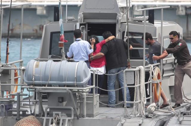 Les migrants étaient gravement déshydratés lorsqu'on les a... (Associated Press)