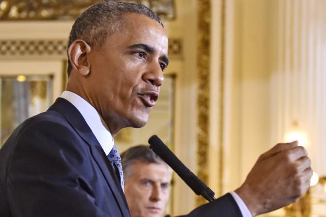 Le président Obama en conférence de presse, à... (PHOTO NICHOLAS KAMM, AFP)