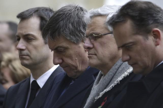Le ministre Jan Jambon à une cérémonie hommage... (Agence France-Presse)