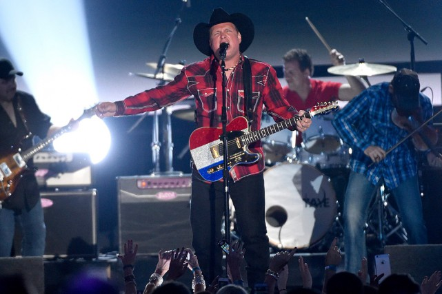La légende de la musique country offre une... (Photo archives AP)