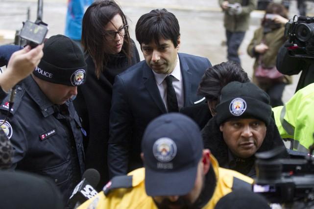 Jian Ghomeshi à son arrivée au palais de... (La Presse Canadienne, Chris Young)