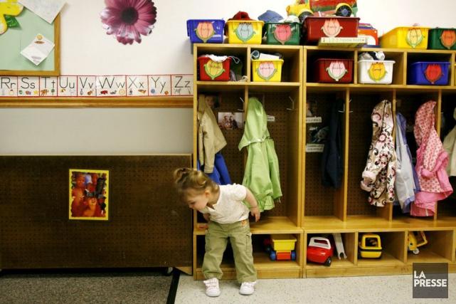 Les enfants qui jouissent d'une place à temps... (Archives AP)