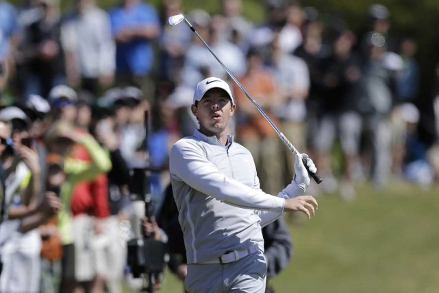 Rory McIlroy a eu le dessus sur Kevin... (Associated Press)