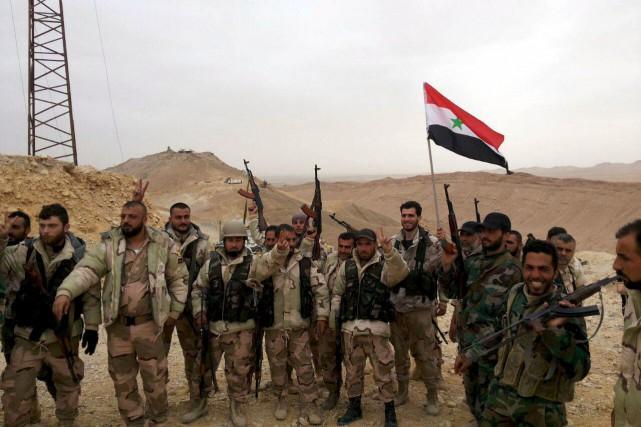 Des soldats de l'armée syrienne à Palmyre.... (PHOTO REUTERS/SANA)