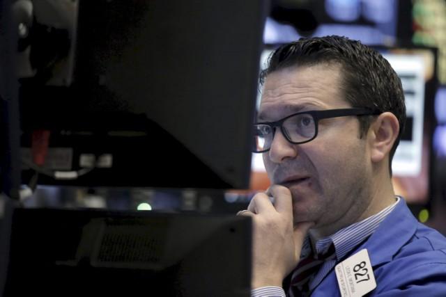Wall Street a tenté d'inverser la tendance en... (PHOTO BRENDAN MCDERMID, REUTERS)