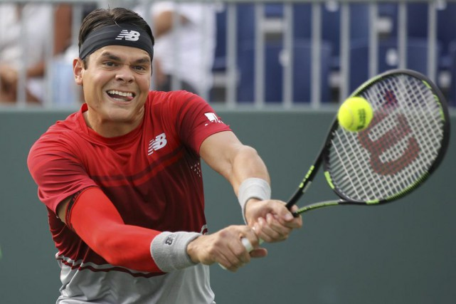 Milos Raonic... (Luis M. Alvarez, Associated Press)