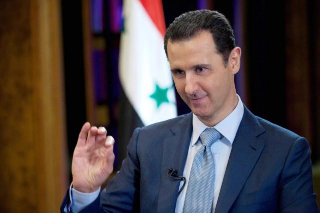Bachar al-Assad a estimé «logique que des forces... (PHOTO SANA VIA AP)
