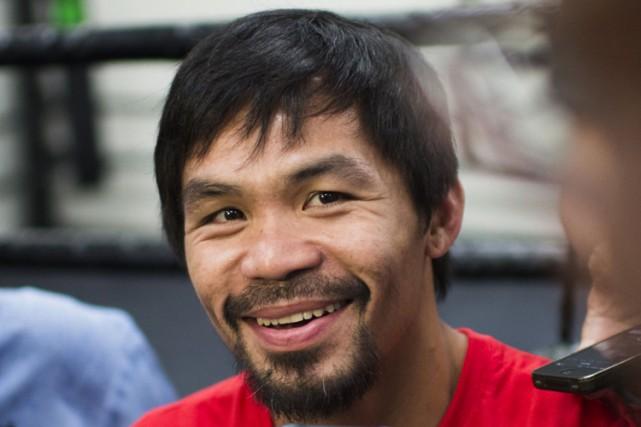 Manny Pacquiao en entrevue avant son entraînemnet au... (PHOTO AFP)