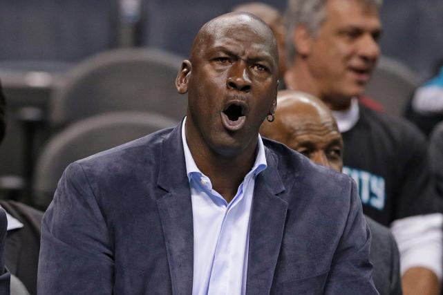 Michael Jordana notamment reçu 100 millions de dollars... (Photo Chuck Burton, AP)