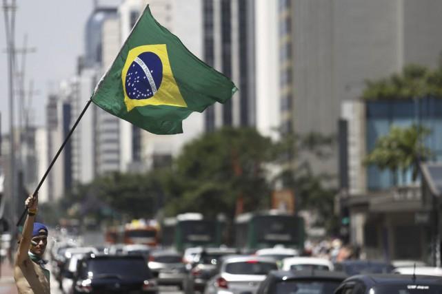 À Rio de Janeiro, ville hôte des JO... (Photo Miguel Schincariol, Archives AFP)