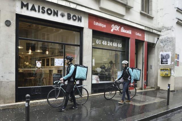 Les cyclistes-livreurs de Deliveroo.... (PHOTO AFP)