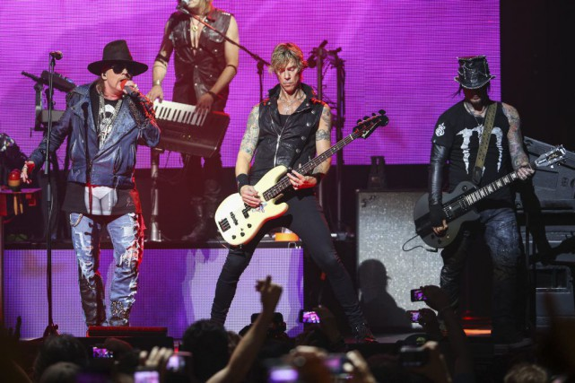 Le groupe rock Guns N' Roses, en tournée nord-américaine, a été retenu... (Photo Paul A. Hebert, Invision/Archives AP)