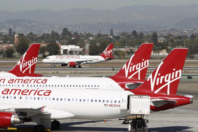 Virgin America, lancée en 2007, occupe présentement la... (PHOTO DAVID MCNEW, ARCHIVES REUTERS)
