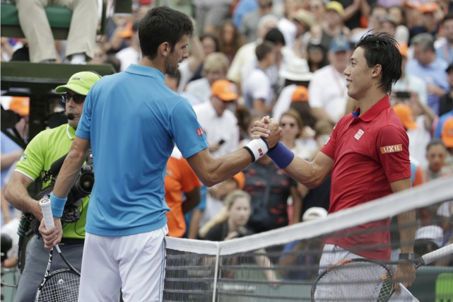 Novak Djokovic (à gauche) a signé une sixième... (Associated Press)