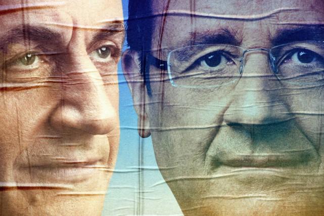 Des affiches électorales des deux principaux candidats de... (PHOTO PHILIPPE HUGUEN, ARCHIVES REUTERS)